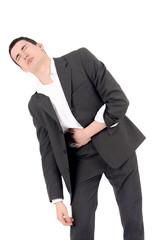 Sad business man having pain, stomach ache.