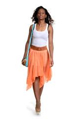 black woman walking wearing orange skirt