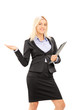 Young blond businesswoman holding a clipboard and gesturing