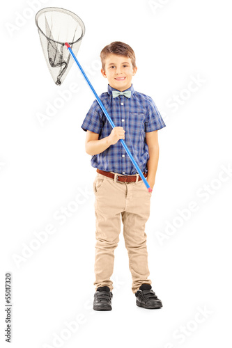 Full length portrait of a kid holding a butterfly net