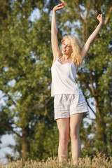 Pretty blond woman refreshing in the morning