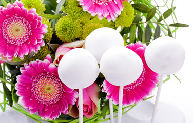 white cake pops with purple flower