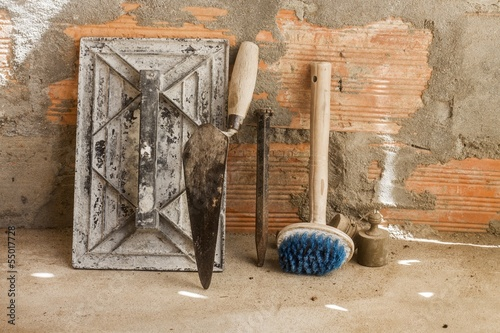 cement mortar tools with brick wall Poster