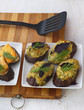 Slices of grilled eggplant with cottage and cheese