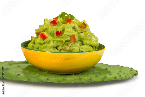 Guacamole on green cactus leaf.