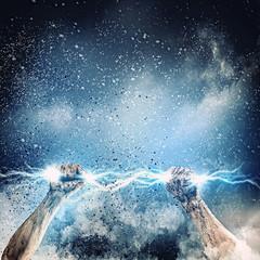 Human hand holding lightning