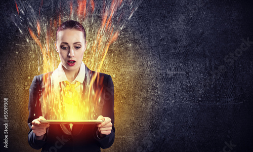Young business woman with ipad