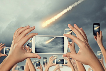 People taking photo of meteorite