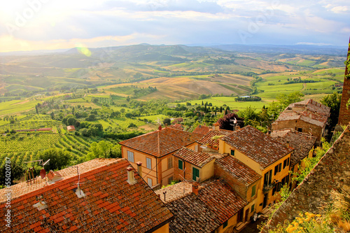 View over the fields of Tucany from Montepulciano near sunset - 55020787