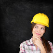 Construction worker woman on chalkboard texture