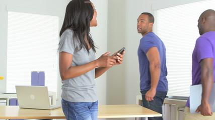 Black businesswoman takes photos of colleagues