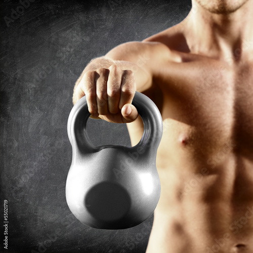 Kettlebell dumbbell - fitness man lifting weight