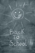 Back to school and happy sun on chalkboard