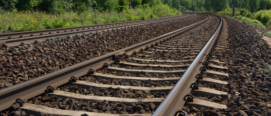 Railway tracks in rural area ending to horizon