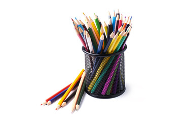 colored pencils in basket on white background