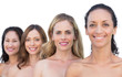 Smiling nude models posing in a line looking at camera