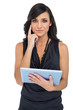 Pensive elegant brown haired model holding tablet