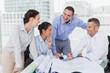 Architects anaylzing plans together