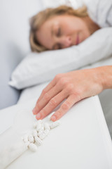Blonde woman lying motionless after overdose of pills