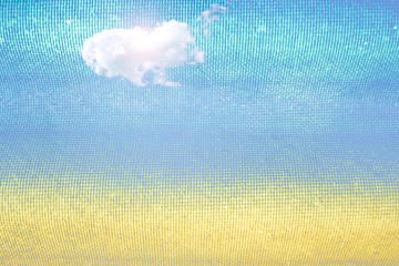 Summer abstract background texture with clouds. Golden sand beac