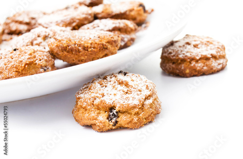 Pile of chocolate chip cookies on a dish on white background