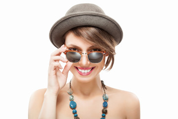 Smiling girl in sunglasses and hat