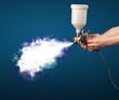 Leinwanddruck Bild - Painter with airbrush gun and white magical smoke
