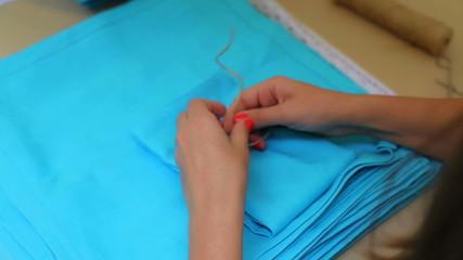 beautiful girl turns napkins and ties