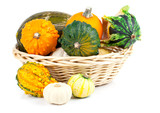 Autumn pumpkins in a straw basket