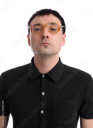 Funny portrait of young nerd with eyeglasses isolated on white b