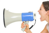 Young woman shouting through megaphone