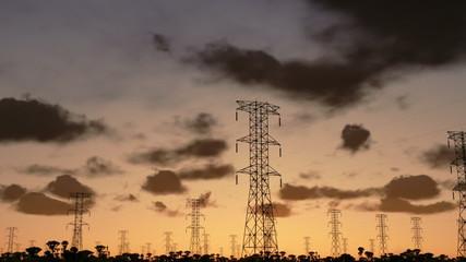 Electricity pillars, timelapse sunrise, camera panning