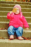 toddler girl with leaf