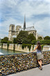 Tourist girl in front of the Notre Dame de Paris