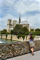 Tourist girl in front of the Notre Dame de Paris