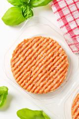 Raw burger patty