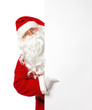 Santa Claus pointing on a blank advertisement banner