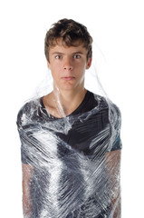 Boy wrapped in shrinkwrap cellophane