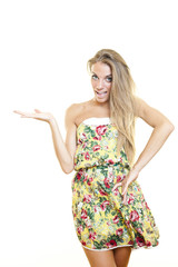 Young surprised cute woman with fashion dress showing product