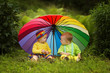 little children under colorful umbrella