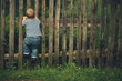little funny boy with fence