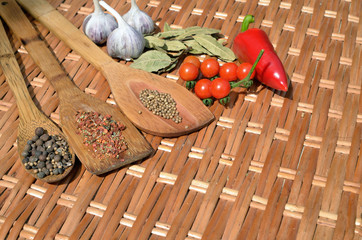 still life of of vegetables and spices on a wicker table