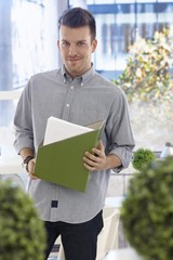 Portrait of young casual office worker smiling