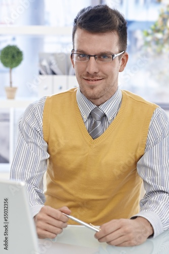 Portrait of happy businessman in glasses