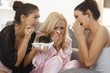 Female friends crying together at home