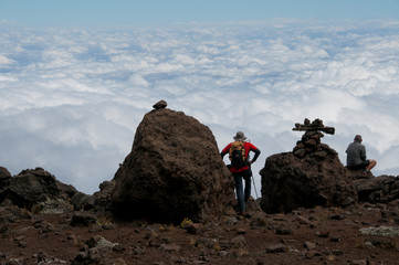 Trekkers gazing over the clouds