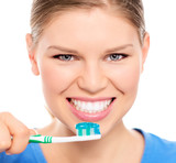 Happy woman showing her perfect white teeth holding brush