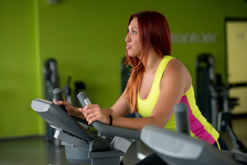 Young woman training on an exercise bike