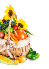 autumnal harvest vegetable and fruit in basket isolated on
