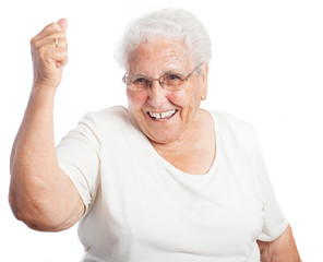 Elder woman celebrating something on a white background